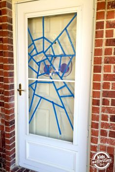 Super cute Halloween front door idea! Eyeballs and a spider web!