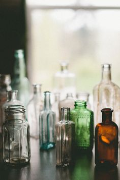 Mixed vintage bottles and jars make great decoration either empty of for single flower stems Small Glass Bottles, Antique Bottles, Vintage Bottles, Bottles And Jars, Antique Glass, Glass Jars, Mason Jars, Perfume Bottles, Apothecary Jars