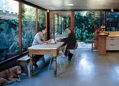 The couple relax in their open-plan kitchen with their twelve-year-old lab, Uma.