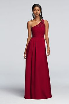 The gathered satin skirt on this long one-shoulder bridesmaid dress makes it fit for a formal wedding, while the illusion lace sweetheart bodice adds a vintage touch.   Features a side slit and grosgr