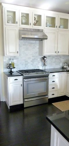 Love the white cabinets with the brick back splash