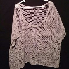 "Torrid Fishnet Top Pre-owned torrid short sleeve fishnet style top. This top is gray and measures approximately 24"" long and 29"" wide. Excellent condition would look great over a pink cami. Torrid Tops"