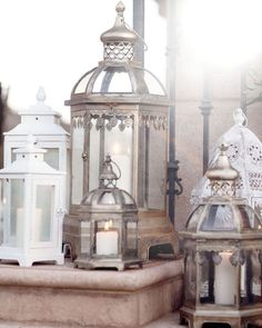 Love the idea of assorted white & metallic lanterns scattered about the reception space for your winter wonderland wedding