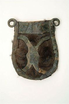 9-11th Century, Birka, Sweden. Metal mounts from a bag from Grave 958, Birka. This type is quite widespread in Baltic sea region. The fur is not original but was mounted in 19th Century for exhibition.