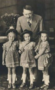 hitler and three girls. Later a painting was made of Hitler with the girl in the middle.