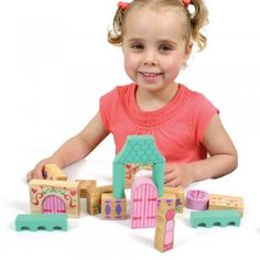This unusual Fairytale Wooden Building Blocks set contains over 45 fairytale themed, brightly coloured, solid rubber wood blocks which can be used to create endless fairytale palaces for all your play characters.