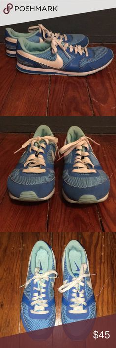 Nike sneakers Gently used bright blue Nikes. Slight wear in the coloring by the swish on the sides as shown. Shoe lace is stained on one shoe but can be easily replaced with a new set of laces. Years of life left as shown from the soles and insides!! Size 8.5 Nike Shoes Sneakers
