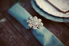 pretty blue napkin and vintage rhinestone napkin holder {styled and captured by http://dellafiora.com/}