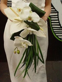 Tropical leaf and white orchid wedding bouquet  / http://www.himisspuff.com/green-tropical-leaves-wedding-ideas/