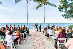 Red Rose Pedals for Ceremony at Key Largo Lighthouse Beach Wedding Venue in the Florida Keys