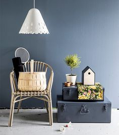 Aamu ceiling light, design Kirsi Enkovaara, Innojok / Holmsel wicker chair and white Socker planter, Ikea / Metal trunks, Granit.