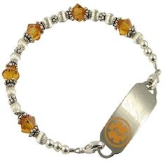 "A dazzling display of Swarovski crystal beads are displayed in this all sterling silver medical ID bracelet.   Engraving is always free at Stylish Medical ID, and includes several font choices. The stainless medical ID tag will accommodate a total of 5 lines of engraving and measures about 1.7"" by .05.   http://www.stylishmedicalid.com/"