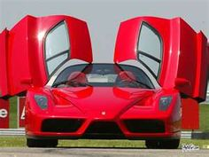 Dream car -- red ferrari with wing doors