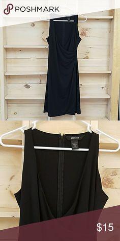 Little black dress from Express Mock wrap with zipper back. Very flattering cut. Size 5/6. Express Dresses