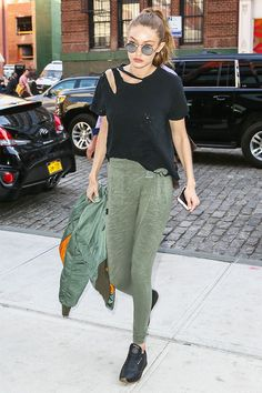 Gigi Hadid's sweats-and-sneakers pairing will make you want to buy these classic kicks ASAP. See and shop the look here.