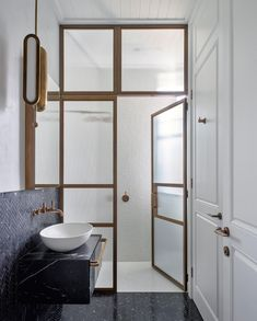 """FREDDIE on Instagram: """"""""A small powder room conceals a shower within this wet room. We used a brass framed screen and hammered glass to conceal the shower whilst…"""" Brass Bathroom, Bathroom Interior, Master Bathroom, Washroom, Bathroom Vanities, Bathroom Design Inspiration, Design Ideas, Hill Interiors, Vogue Living"""