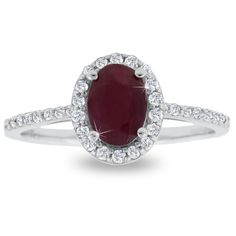 This ruby and halo diamond ring features a 1 carat oval shape ruby measuring 7x5 mm. The ruby is surrounded by 32 sparkling diamonds in J-K color, I1-I2 clarity at 0.20 carats. Total gem weight is 1.20 carats.
