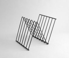 Mid Century Metal Magazine Rack. $35.00, via Etsy.