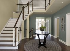 Formal Sophisticated Entry - Muted gray-blue paint colors anchor a busy entryway. Benjamin Moore Templeton Gray HC-161 (Walls), Carrington  Beige HC-93 (ceiling) and Flora AF-470 (Hallway)