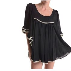 Boho tunic. Re-posh. Too big This is a comfy and cute black boho style tunic with ivory trim. Is to be worn very loose fitting. Ciel Tops Tunics