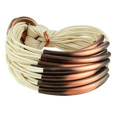 Gillian Julius Multi Tube Bracelet, Copper | Crème Cord. Multi strand bracelet consisting of 20 waxed cotton cords. Each cord of bracelet features a copper tube. $286