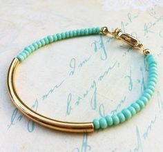 Mint gold bar bracelet - minimalist jewelry - friendship bracelet, Minimal bracelet with Golden tube. $15,00, via Etsy.