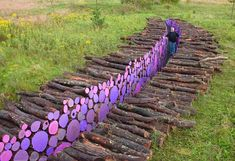 Firewood as Art:  Michael McGillis, 'Wake' was originally installed in 2006 at the Franconia Sculpture Park in Shafer, Minnesota and consisted of a 95-foot long trench of cut trees painted purple in the middle.