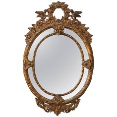 French Louis XV Style Giltwood Mirror | From a unique collection of antique and modern wall mirrors at https://www.1stdibs.com/furniture/mirrors/wall-mirrors/
