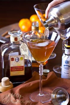 Spiced Manhattan  (■2.5 oz Hennessy cognac  ■.75 oz spice infused vermouth (recipe on linked page)  ■Dash of angostura bitters  ■Twist of orange  ■Sprinkle of fresh nutmeg)