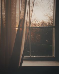 I stare through sun lit windows I stare for hours I gaze at horizon that is a distant memory now...