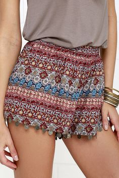 When you're making eyes across the fire at that special someone, the Sparks Fly Red Print Shorts will really catch their eye! From a banded elastic waist a taupe, ivory, grey, blue, and red Boho print falls to cute shorts with coin-accented hems that jingle lightly with every step! Front diagonal pockets.