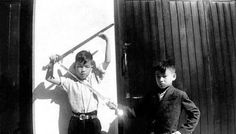A young Bruce Lee playing with his brother