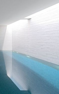 The inspiration for a contemporary indoor rectangular and tile pool house reorganize in Cheshire probably too difficult to construct, but could be insulated with ease and could put doors upon both sides to allow let breathe through. Children Swimming Pool, Swimming Pools Backyard, Swimming Pool Designs, Indoor Pools, Underground Pool, Simple Pool, Moderne Pools, Pool Water Features, Basement Pool