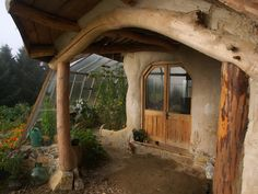 Cob house porch and green house