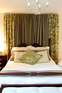 ... Wall Of Airy White Curtains. In The Guest Bedroom, Curran Created A  Canopy In Rich Brown And Green Fabric To