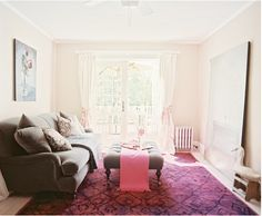 Love the clean whites with a brightly colored rug.