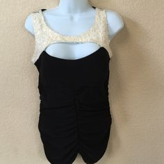 Sexy black with front sequences blouse Beautiful stretchy classy sleeveless open front and back blouse. Lightly padded built in bra. Gorgeously detailed with off white sequence on upper top of the front blouse. Jacaranda Tops Blouses