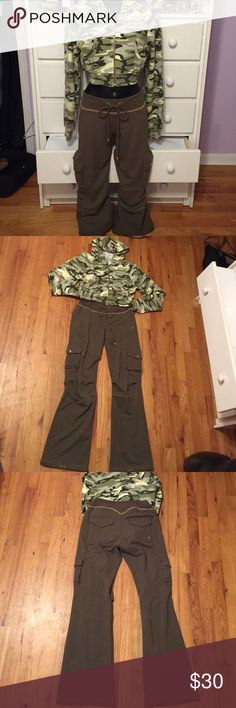 Camouflage Cropped Hoodie & Sweatpants Set This outfit is super cute together. It's in very good used condition and was purchased as a set. The top is an XL and the bottoms are a L. I'm pretty sure these are junior sizes as the top fits like an adult S or M and the pants can probably fit all the way up to a women's 8-10. The pants have a lot of stretch in the waist band. There is one tiny practically unnoticeable spot on the pants as shown in picture 4. Self Esteem Tops Sweatshirts & Hoodies