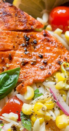 Grilled Salmon & Orzo Corn Salad ~ A light and refreshing orzo salad with fresh, sweet summer corn, tomatoes, basil, parsley, onion and a lemon viniagrette served with a tender grilled wild caught salmon fillet
