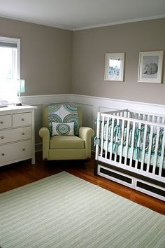 Wainscoting in the nursery makes the room look bigger, feel more custom, and protects the walls