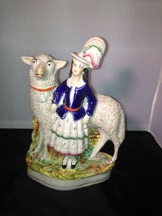 Antique Staffordshire Pottery girl with lamb circa 1850