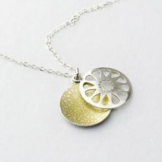 Geometric panel pendant - hand cut and etched sterling silver with a sealed gold pigment.