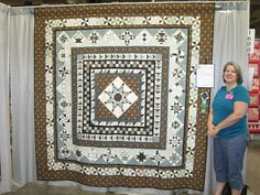 Sue Garmin pattern, Stars for a New Day.  I have a great photo of this quilt in black and white from the Lancaster Quilt Show 2013.