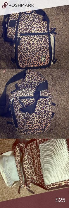 Cheetah Print Purse or travel bag by Travelmate Cheetah print travel bag. I used it as a purse but only used it twice so it's like new! It has several compartments for everything and would be great for vacations or a carry on or even just an every day purse. Super cute and trendy! Travelmate Bags Travel Bags