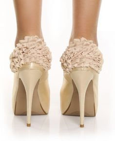 ruffles. would be perfect wedding shoes.