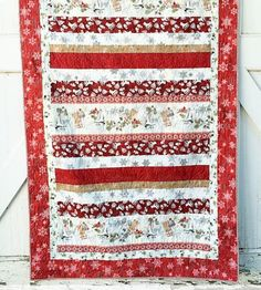 Create a gorgeous and simple strip quilt that& perfect for using up your winter jelly rolls with this Winter Celebration Strip Quilt Pattern. Made in stunning winter colors like berry red, snowy white, and rich gold, this strip quilt pattern is the Strip Quilt Patterns, Christmas Quilt Patterns, Jelly Roll Quilt Patterns, Strip Quilts, Easy Quilts, Quilt Blocks, Amish Quilts, Christmas Sewing, Red And White Quilts