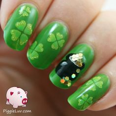 Happy St. Patrick's Day! I made this nail art using OPI Greenwich Village, which is the perfect green for this occasion, and I hand painted the clovers and the pot of gold with acrylic paint.