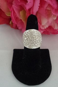 Pave Rhinestone Ring Set in Silvertone Metal that will stretch to fit any size finger. You can see photos of the ring and many other rings in our vintage jewelry store at www.CCCsVintageJewelry.com. Have a great vintage day. Best, Coco