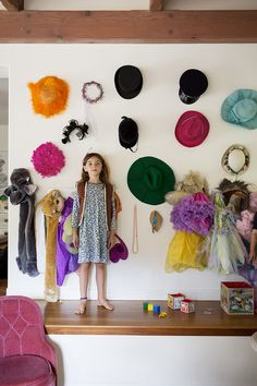 Creative Kids' Spaces that Capture the Imagination: Ruthie Sommers hangs a collection of costume hats and dress up accessories on a wall for her three girls.