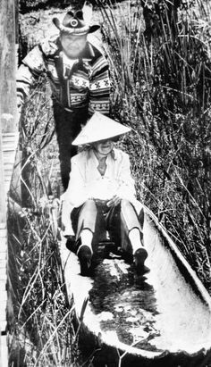 Marjory Stoneman Douglas canoeing with a Miccosukee Indian at the Miccosukee Cultural Center in the Everglades, 1983